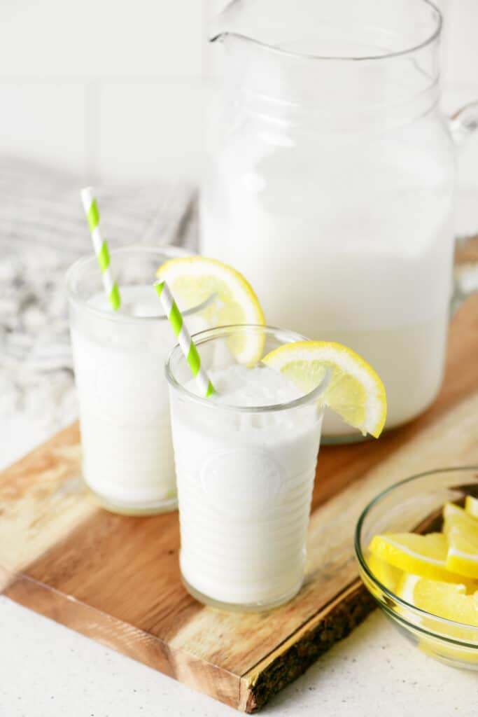 whipped lemonade in two glasses garnished with lemon slices