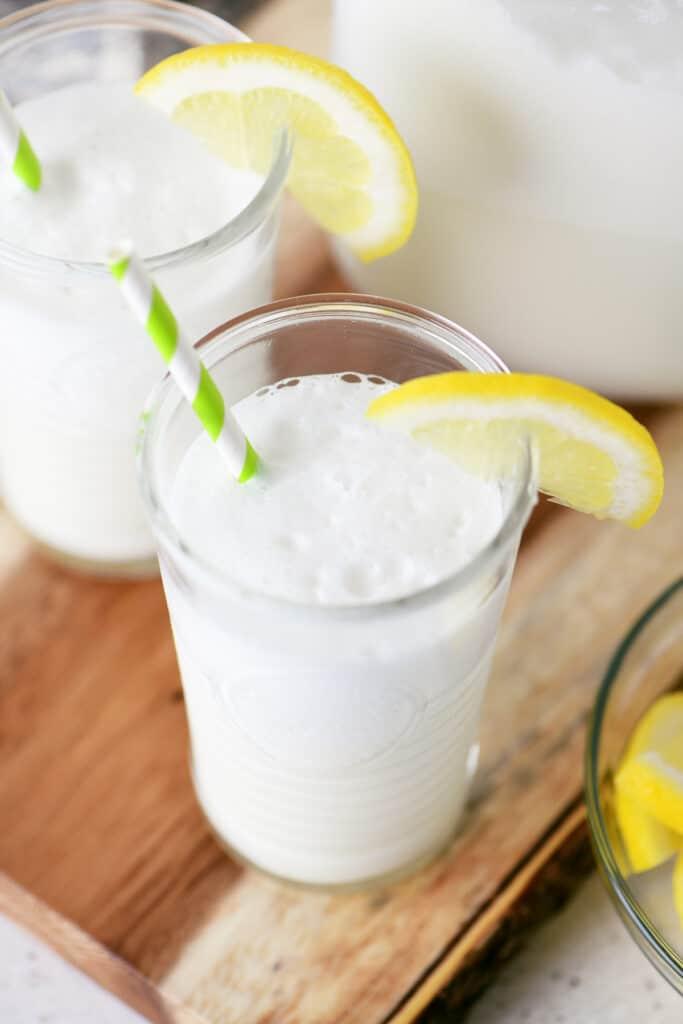 whipped lemonade julius in to tall glasses with lemon garnish
