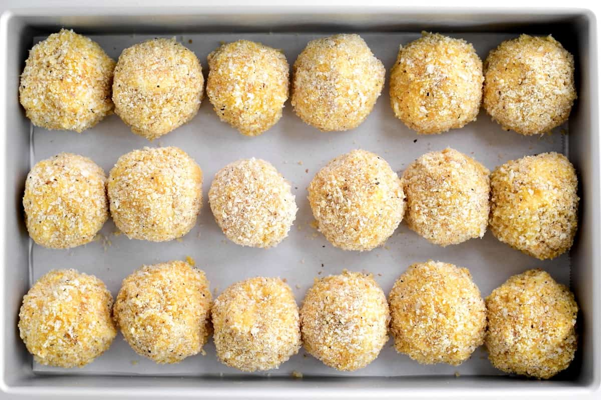 pan of uncooked loaded potato poppers