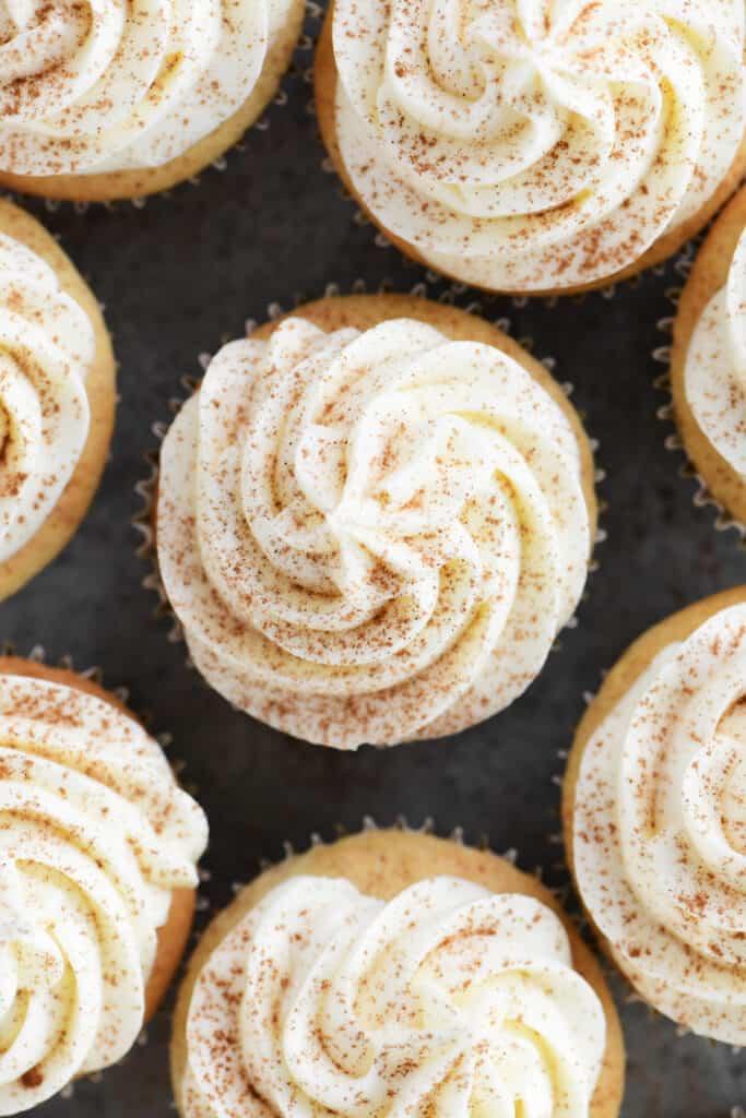 swirled cream cheese buttercream sprinkled with ground cinnamon