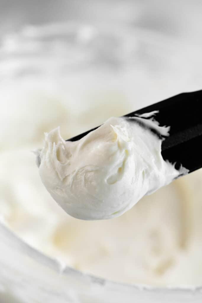 cream cheese buttercream on a spatula