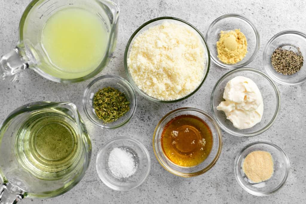 salad dressing ingredients in bowls