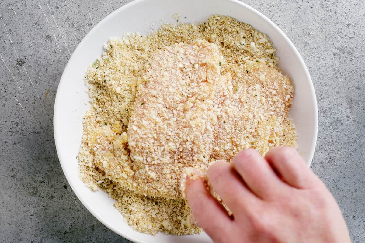 coat chicken with parmesan breading