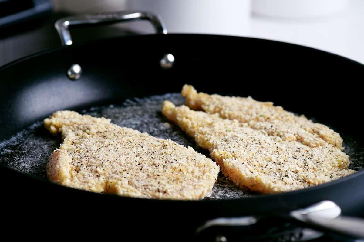 cook parmesan chicken in pan