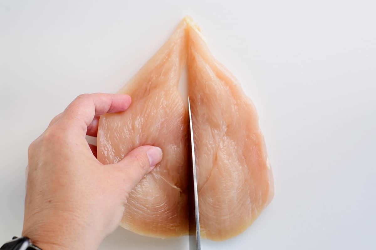 split chicken breast with knife