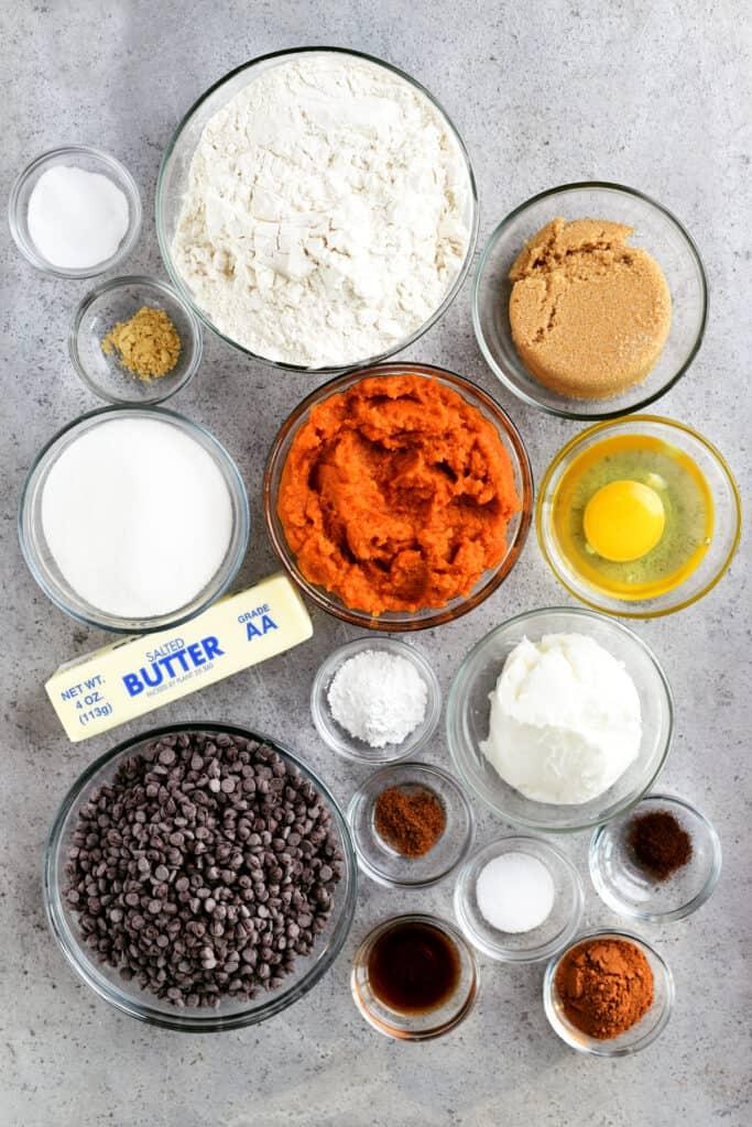 pumpkin chocolate chip cookie ingredients in glass bowls