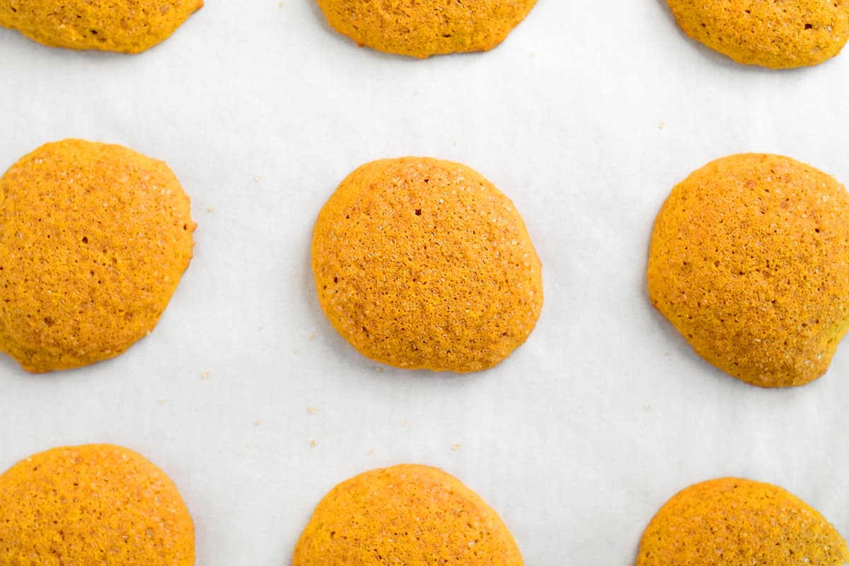 baked pumpkin cookies on parchment