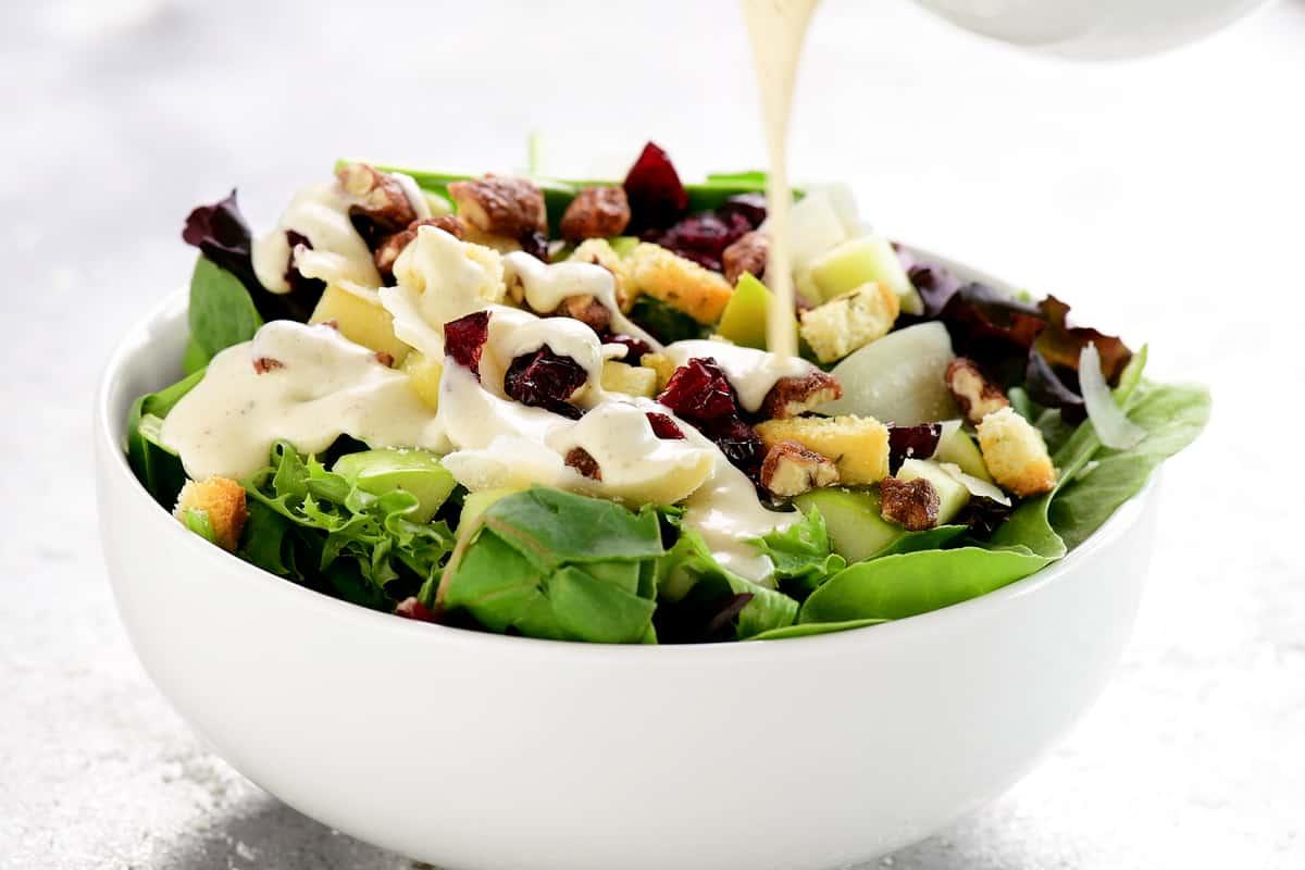 pour dressing on salad