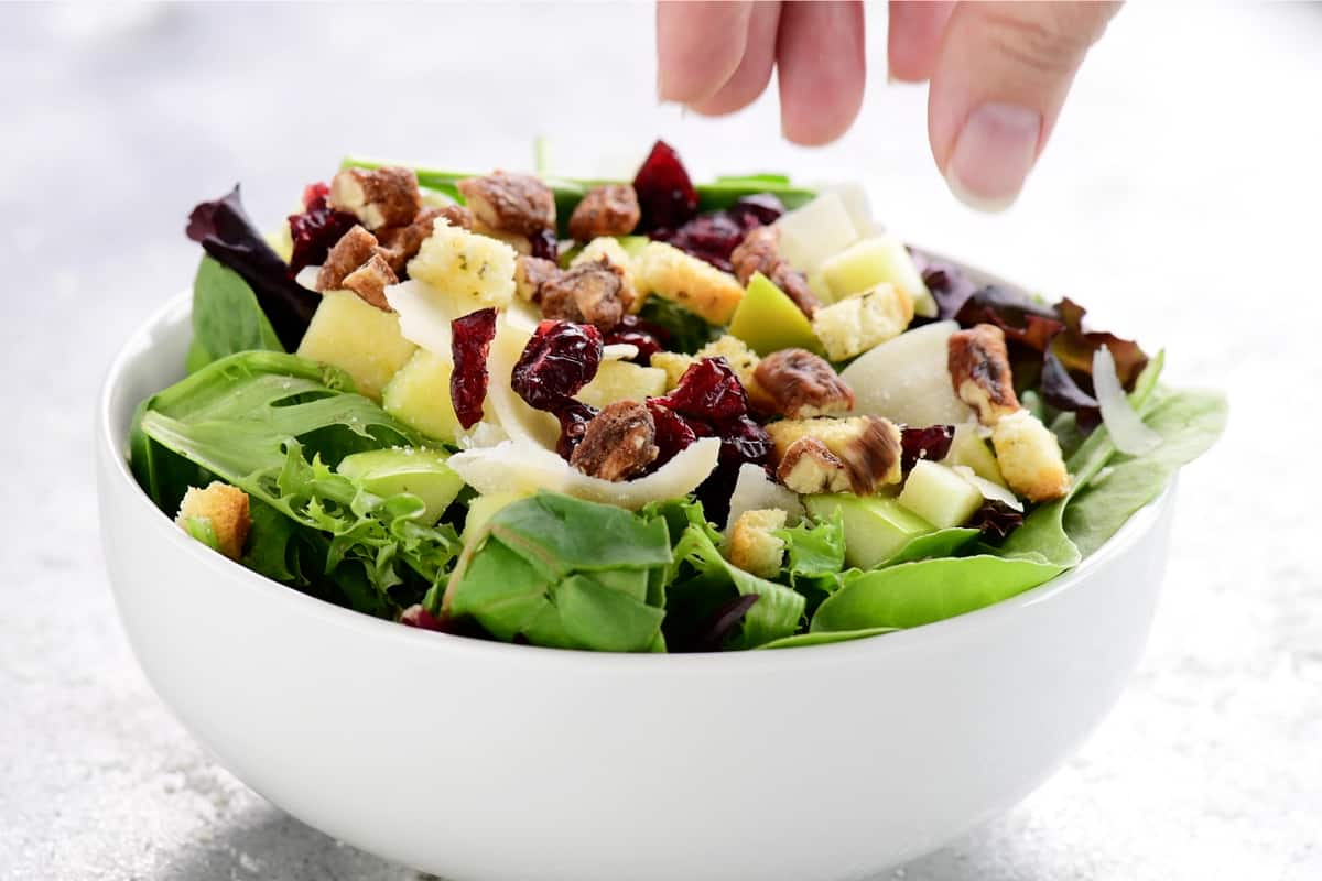 add toppings to salad