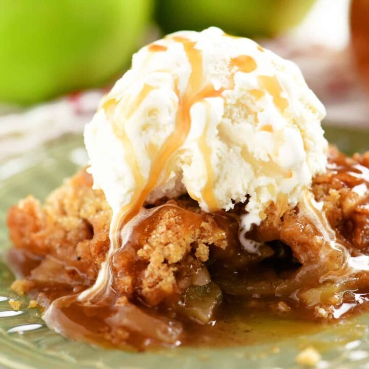 apple crumble on green plate with ice cream on top
