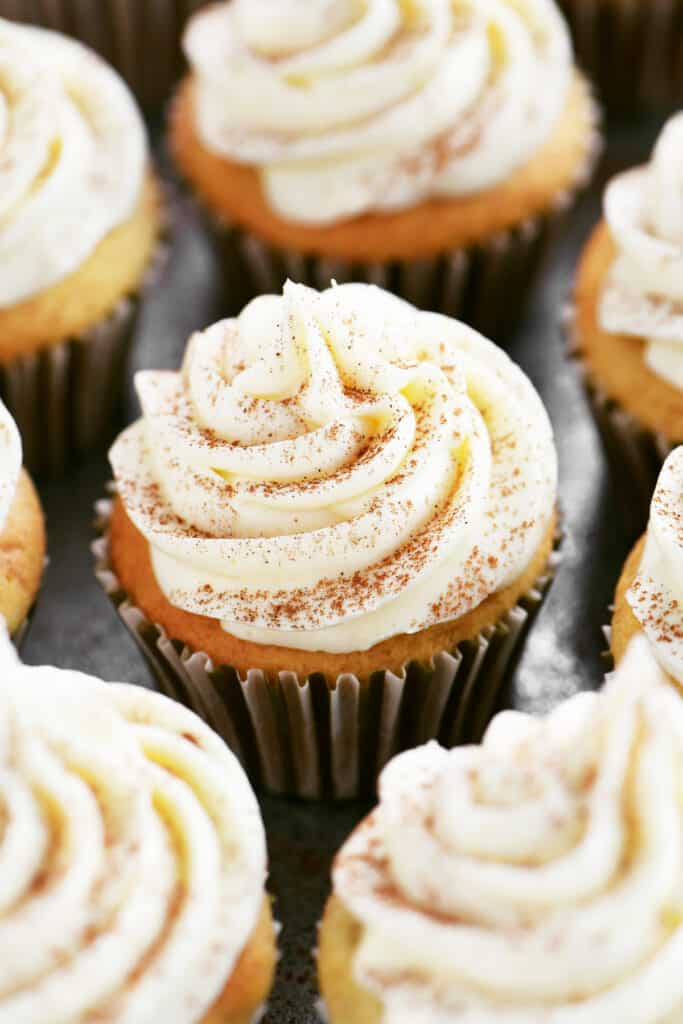 frosted cupcakes with cinnamon sprinkled on top