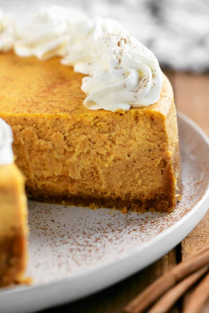 pumpkin cheesecake with a slice removed