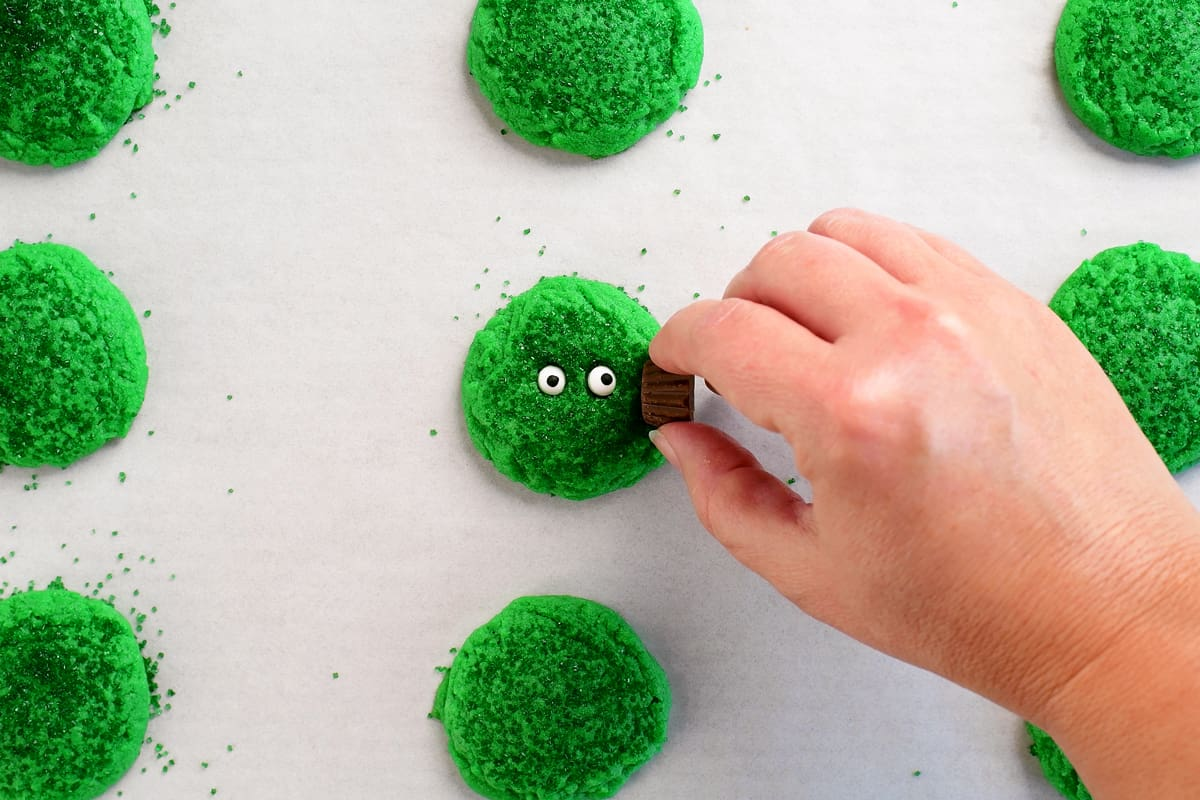 add peanut butter cup ears on green monster cookies