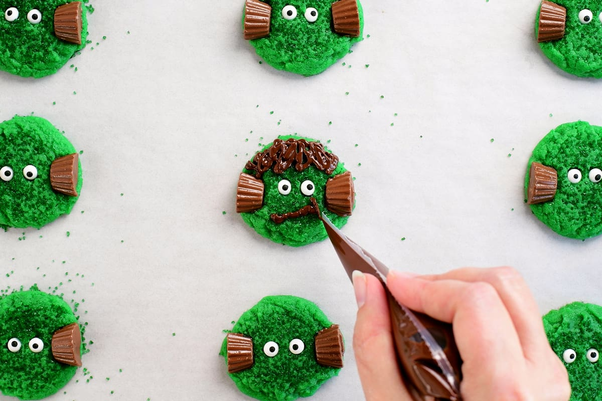pipe melted chocolate mouth on frankenstein cookies