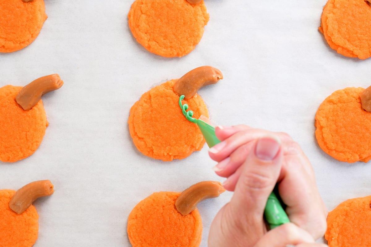 pipe vine on pumpkin sugar cookies