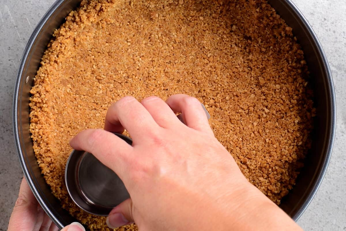 pressing crumbs into springform pan
