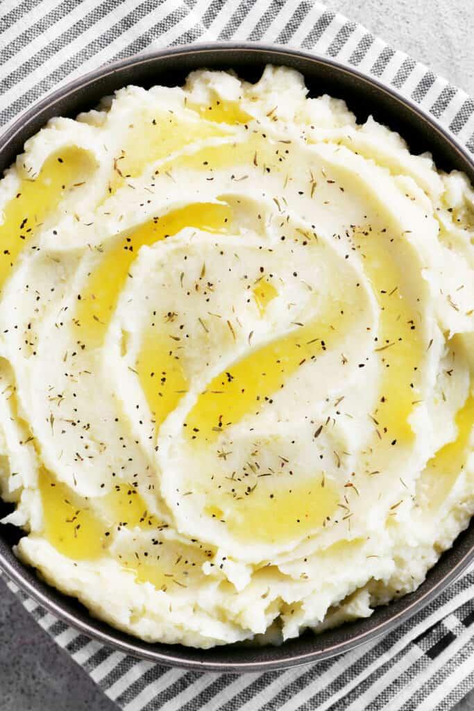 seasoned garlic mashed potatoes in a serving dish